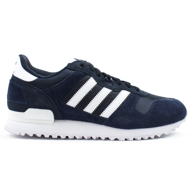 eb0f213438c86 Men s shoes by Adidas in subdued colors. Made of chamois leather and  textile materials in navy blue color. Inserts in white. Subdued colors give  many ...